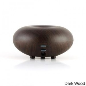 An essential oil diffuser in dark wood